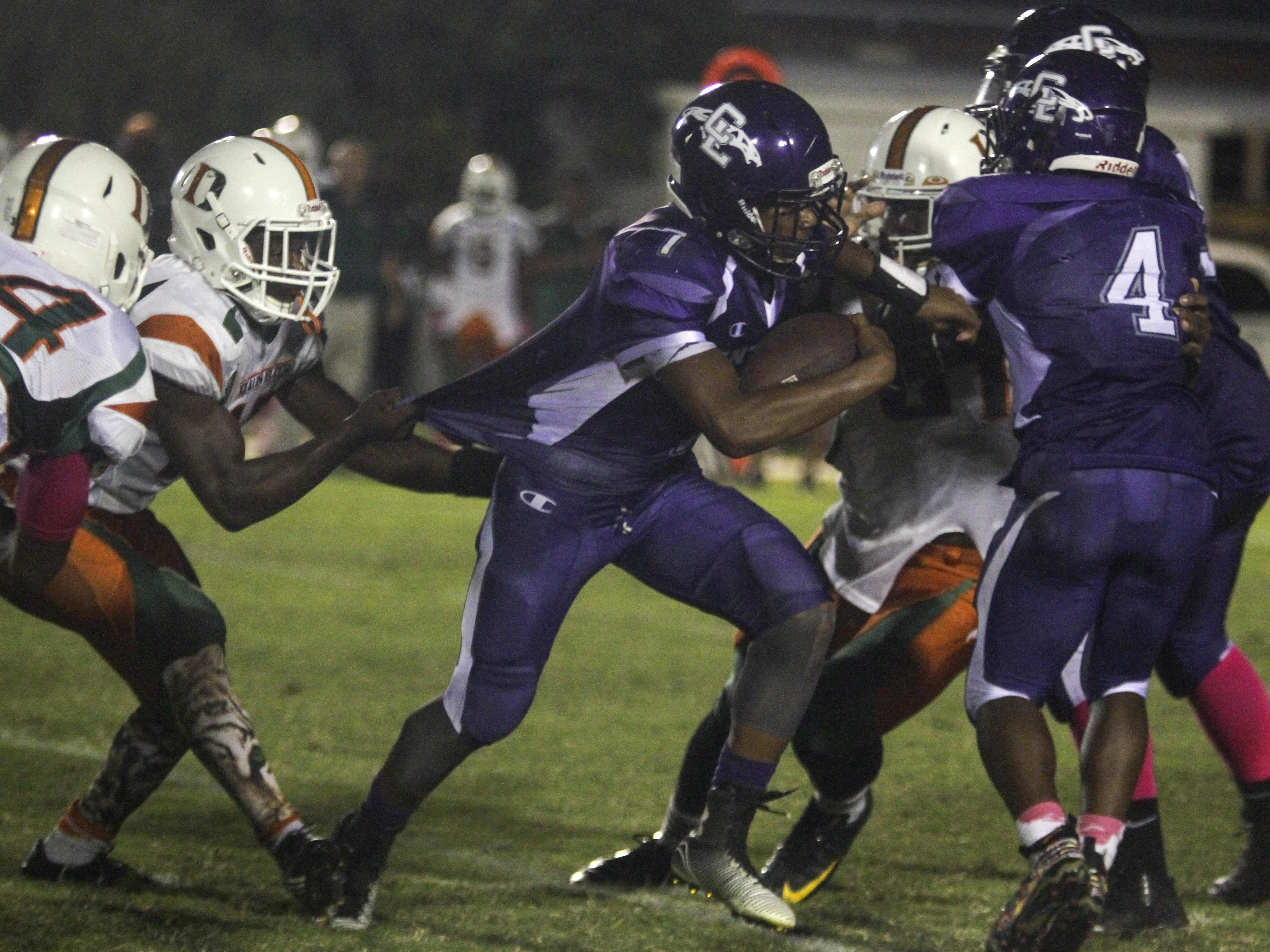 Cypress Lake's Trent Rogers is caught by Dunbar's Lavaris Preston as he runs the ball on Friday, October 16, 2015, in at Cypress Lake High School.