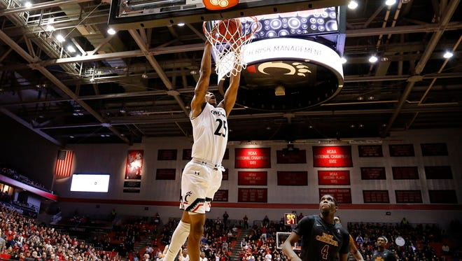 Cincinnati Bearcats guard Kevin Johnson (25) makes a dunk during the second half of the NCAA men's basketball game between the Cincinnati Bearcats and the East Carolina Pirates at Fifth Third Arena on the campus of the University of Cincinnati on Saturday, Feb. 13, 2016. The Bearcats advanced to 19-7 with a 75-60 win over the Pirates.