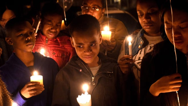 Mourners at a vigil on Jan. 8 for Nate Plummer Jr. included his cousins Ishan Perry, Tyjon Thomas and Shadai Perry; godbrother Nazir Flack; Tyjon's mother,  Shabria Flack; Nazir's mother and Nate's godmother Shawneeq Flack.