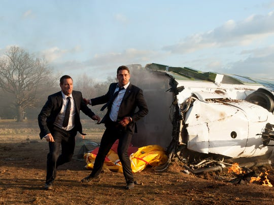"""Gerard Butler, right, plays a Secret Service agent protecting the President,  Aaron Eckhart, left, in """"London Has Fallen."""""""