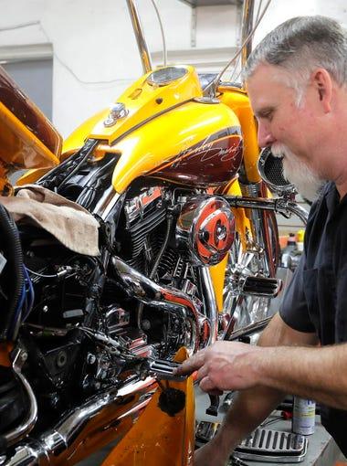 Dean Colegrove, a 30-year veteran mechanic, works on
