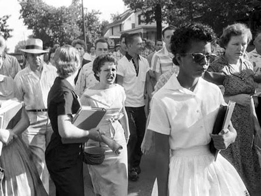 September 4, 1957, Elizabeth Eckford – one of nine black students attempting to attend Central High School, in Little Rock, Arkansas – is met with jeers and turned back by National Guard troops.