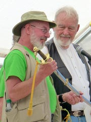 Photographer David Tremblay, left, is presented with a saber from Fort Stanton Live for his spport of the historic fort in many ways including chronicling  its history and current happenings.