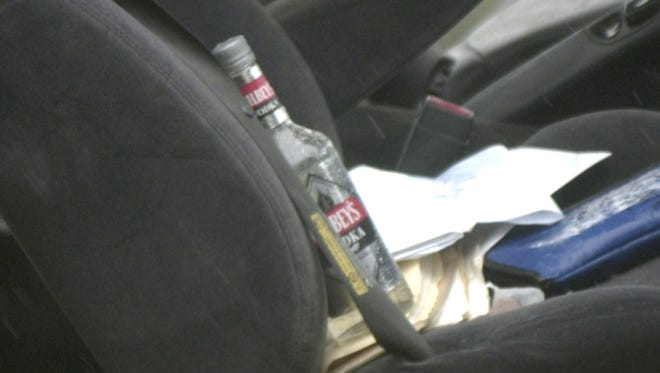 In this 2009 News-Leader file photo, a bottle of vodka is visible in the cab of the pickup. Springfield Police Lt. Faye Barksdale said alcohol was likely a factor in the crash - on the part of the pickup driver.