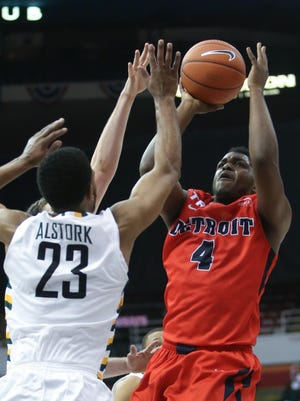 Detroit Mercy's Carlton Brundidge drives against Wright State's Mark Alstork in the first half Sunday at Joe Louis Arena.