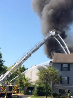 Norwich Township firefighters battling a two-alarm fire on Saturday, July 4, 2020, at an apartment building at the Crystal Lake Apartments complex in Hilliard.