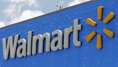 File photo taken in 2017 shows the company sign at a Walmart store in Hialeah Gardens, Fla.