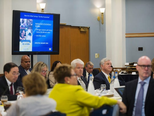 A screen displaying the Go Blue Guarantee information is seen during the Board of Regents meeting on Thursday, June 15, 2017 at the Michigan Union in Ann Arbor.