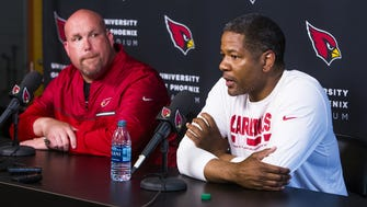 Arizona Cardinals general manager Steve Keim, left, and head coach Steve Wilks talk about the upcoming NFL draft during a press conference at the team training facility in Tempe, Wednesday, April 18, 2018.