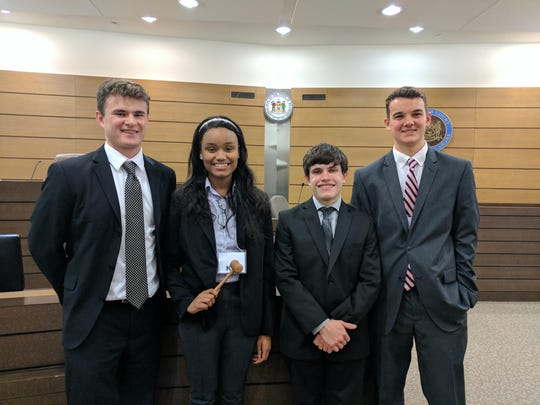 St. Elizabeth seniors Kellen Sweeney, from left, Laini Farrare, Joey Pritchard, and sophomore Brian Millard were awarded gavels for outstanding performance in the Delaware High School Mock Trial competition.