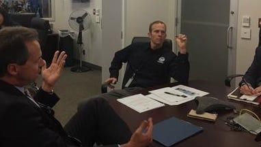 Gov. Steve Bullock, left, meets Thursday with FEMA officials.