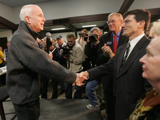 Republican presidential hopeful Sen. John McCain greets