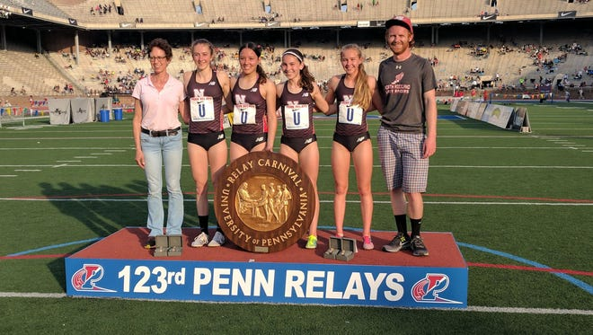 Former Penn Relays' winner Lauren Searby Haines, a Haldane assistant coach, joins Alex Harris, Sofia Housman, Haleigh Morales, Katelyn Tuohy and North Rockland coach Kyle Murphy after the four girls captured the Penn Relays girls Championship of America distance medley relay title April 27, 2017.