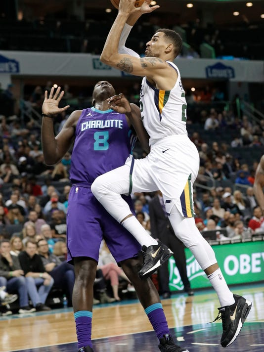 Utah Jazz's Thabo Sefolosha (22) drives against Charlotte Hornets' Johnny O'Bryant III (8) during the first half of an NBA basketball game in Charlotte, N.C., Friday, Jan. 12, 2018. (AP Photo/Chuck Burton)