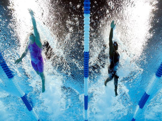 OMAHA, NE - JULY 01:  (L-R) Abbey Weitzeil and  Simone Manuel of the United States compete in the final heat for the Women's 100 Meter Freestyle during Day Six of the 2016 U.S. Olympic Team Swimming Trials at CenturyLink Center on July 1, 2016 in Omaha, Nebraska.  (Photo by Tom Pennington/Getty Images)