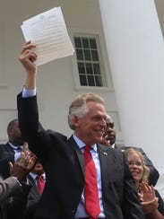 Virginia's Democratic Gov. Terry McAuliffe signed a