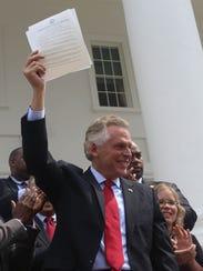 Virginia's Democratic Gov. Terry McAuliffe signed a