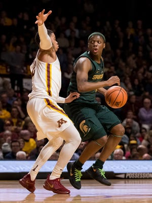 Feb 13, 2018; Minneapolis, MN, USA; Michigan State's Cassius Winston dribbles in the first half against Minnesota's Nate Mason at Williams Arena.