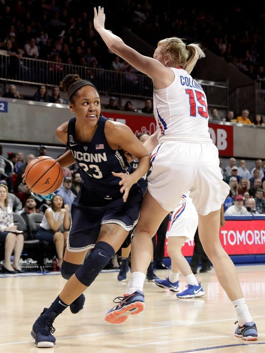 Connecticut guard/forward Katie Lou Samuelson (33) works against SMU forward Stephanie Collins (15) during the first half of an NCAA college basketball game Saturday, Feb. 24, 2018, in Dallas. (AP Photo/Tony Gutierrez)