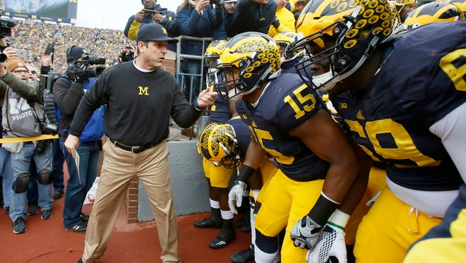 Michigan head coach Jim Harbaugh last words for his players a second before they ran on the field for their football game against Ohio State on Saturday, November 28, 2015, in Ann Arbor.