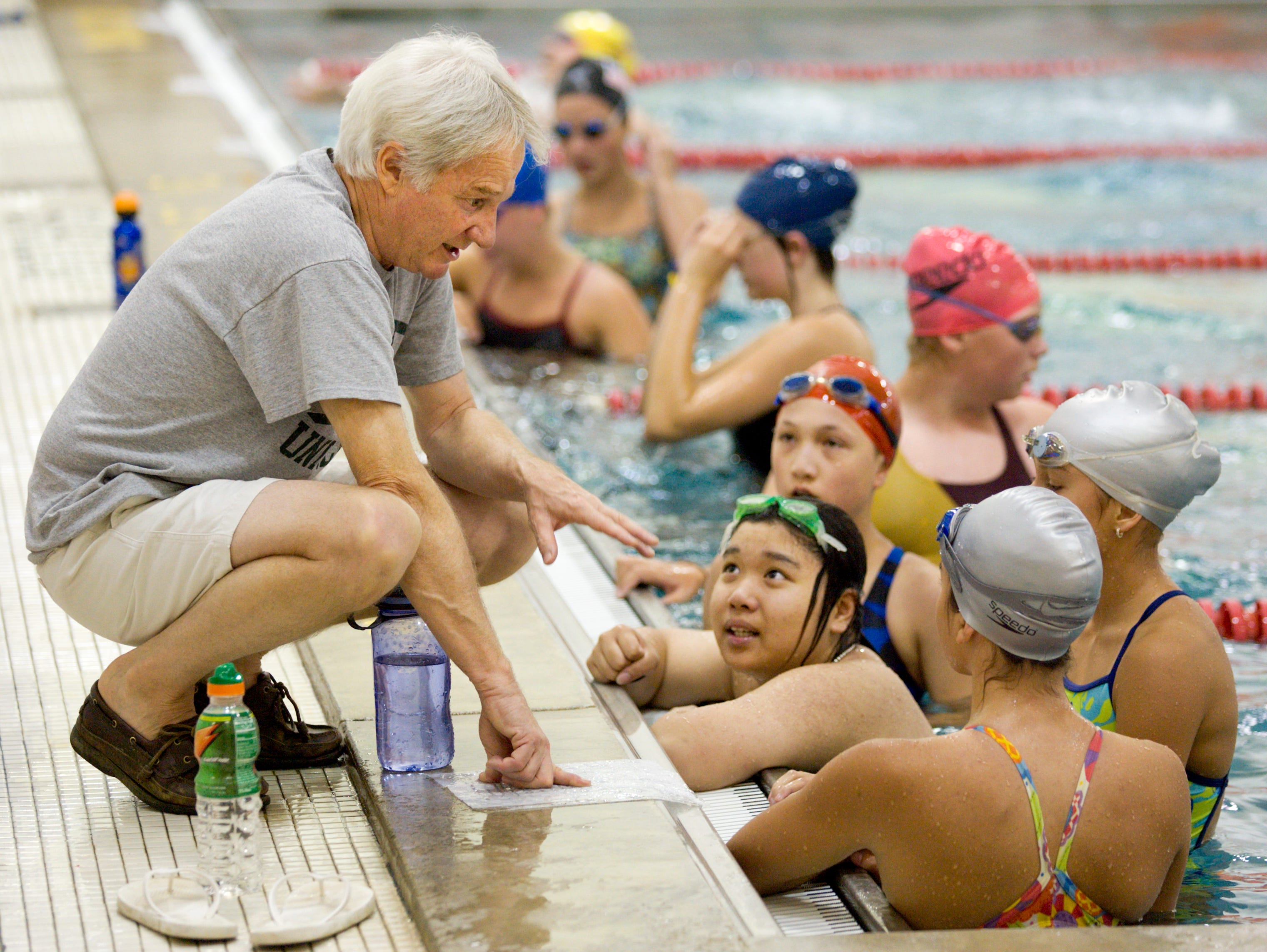 Roy Staley gives instructions to swimmers on his Ithaca High girls' team during the first practice of the 2008 season. Staley, 70, announced his retirement from the position after nearly 40 years of coaching at Ithaca High.