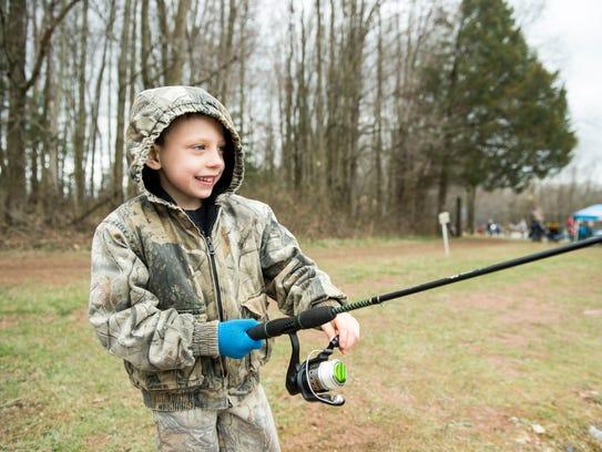 Nathaniel Sterner, 6, fishes at Kaiser Lake in New
