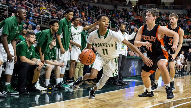 New Haven's Tavares Oliver works the ball down court during an MHSAA Class B state basketball final Saturday, March 25, 2017 at Michigan State University.