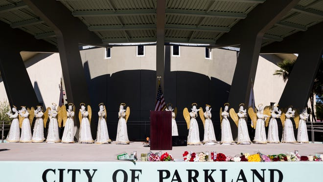 17 angel statues, one for each of the victims of the Marjory Stoneman Douglas High School shooting, line the stage before a 6PM vigil service at Pine Trails Park in Parkland, Fla. on Thursday, Feb. 15, 2018.