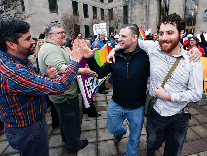 Newly married couple David Roby, center, and Erik Obermiller,
