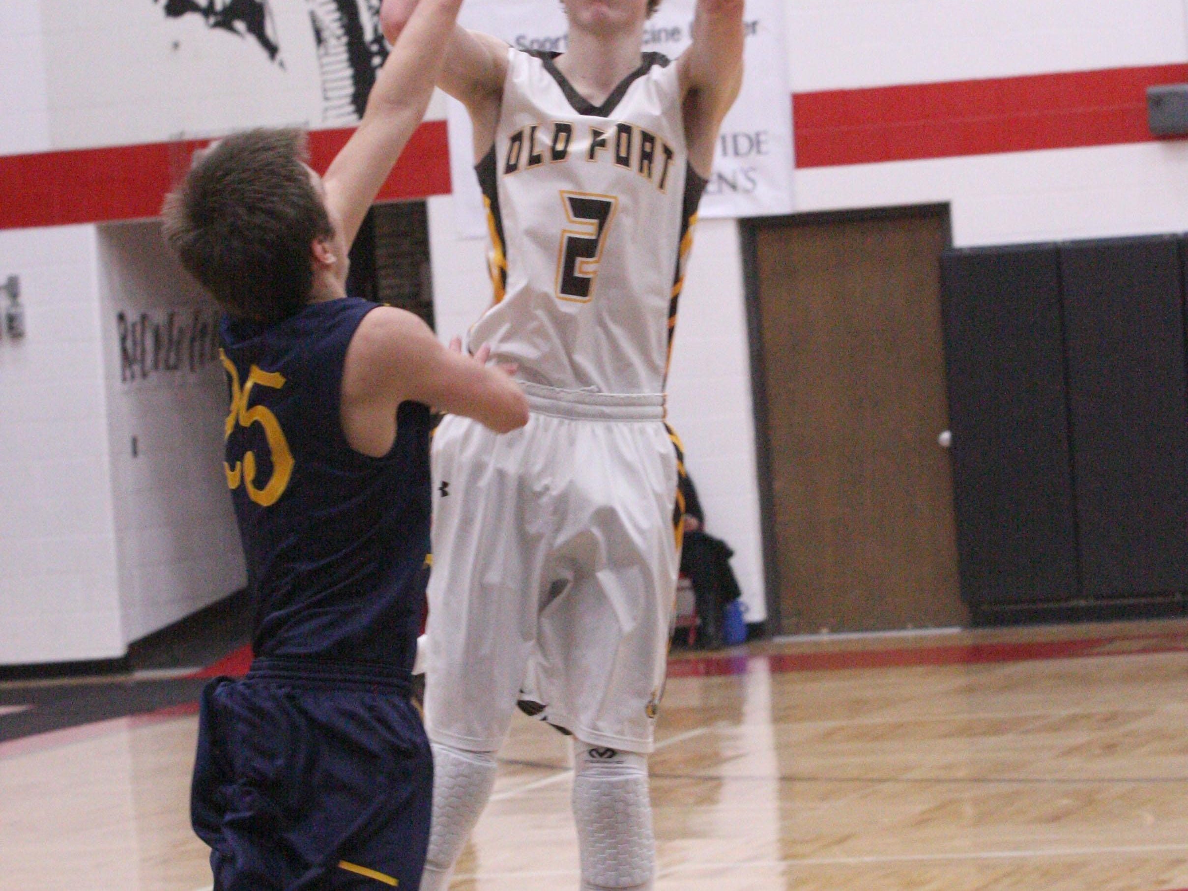 Old Fort's Hootie Cleveland shoots a 3-pointer against New Riegel's Travis Williams.