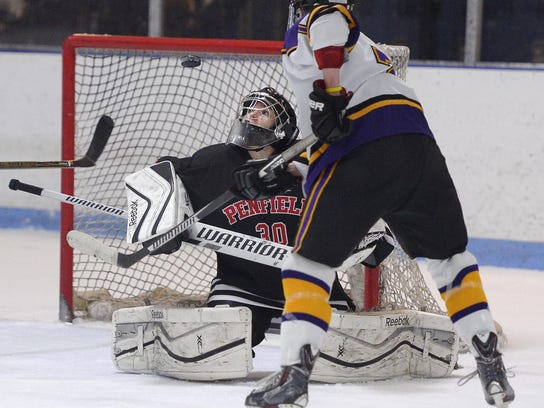 Penfield goalie Lindsay Browning, left, watches the