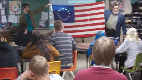 Chuck Kinler, junior vice commander of Bull Shoals VFW Post 1341 gives a presentation on the history of the United Stages flag to art and history students at Flippin High School. Starting from prerevolutionary times, when it was flown for the Continental Congress until our independence became official. He spoke about the 27 different flags that have flown over our nation since then. Students learned about flag etiquette and how to fold the American flag properly. Pamphlets about the flag were handed out and each student received a flag pin.