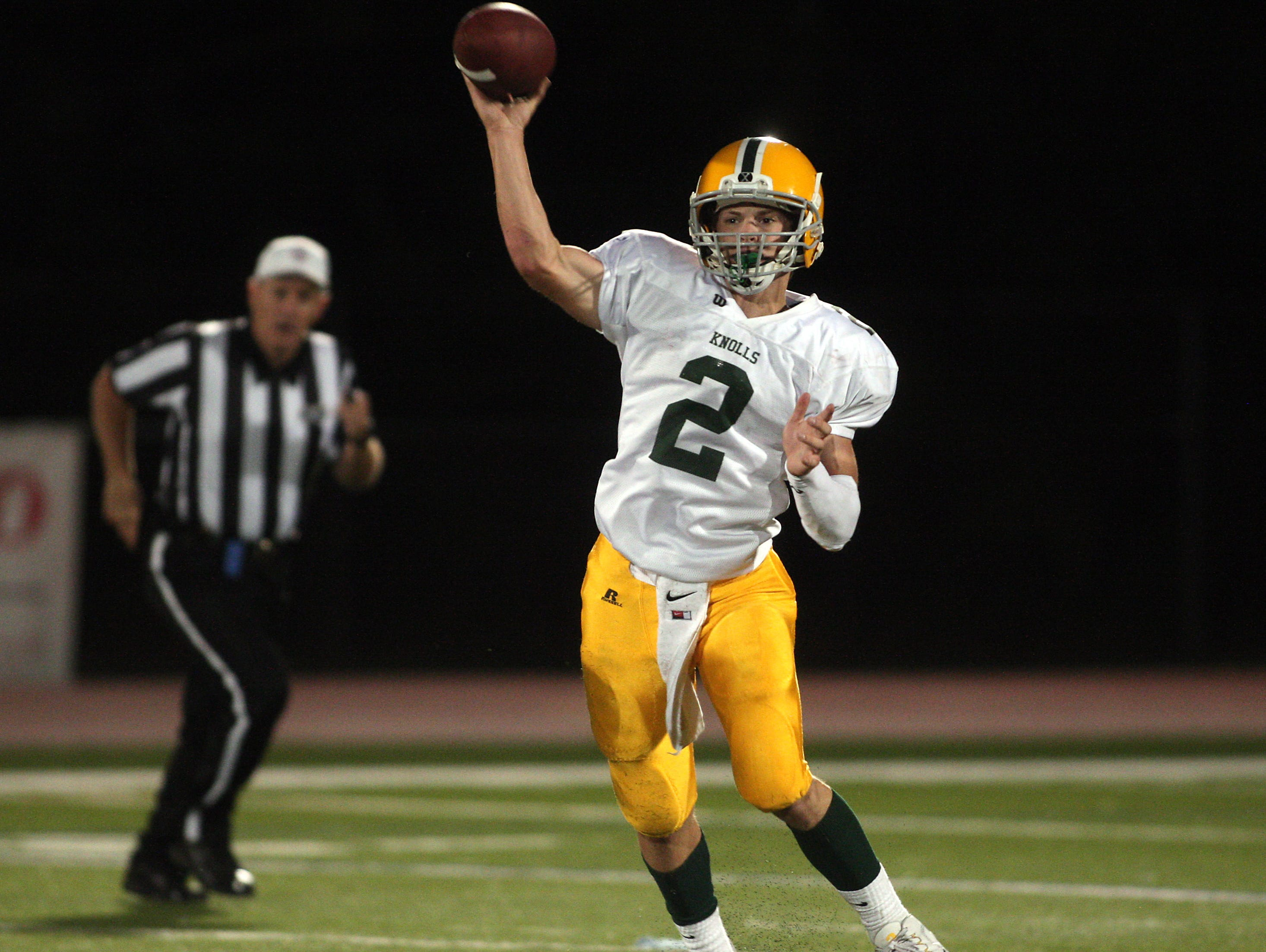 Morris Knolls quarterback Nick Vittorio throws vs Roxbury during their football Friday night matchup. September 25, 2015, Roxbury, NJ.