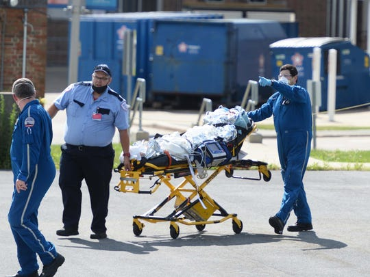A male pedestrian, who was struck by a car at Main and Court streets in Brockton, is loaded into a Boston MedFlight helicopter at Good Samaritan Medical Center in Brockton, Friday, June 12, 2020.