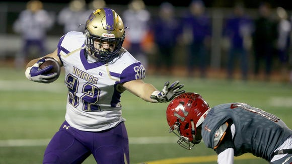North Kitsap running back Dax Solis stiff-arms Dillon Halpin of Archbishop Thomas Murphy during the first half of Friday's game at Veterans Memorial Stadium in Snohomish.