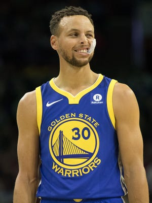 Golden State Warriors guard Stephen Curry (30) reacts against the Philadelphia 76ers during the first quarter at Wells Fargo Center.