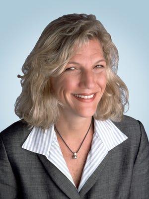Caroline Little. president of the Newspaper Association of America.