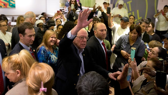 Democratic presidential candidate Sen. Bernie Sanders, I-Vt., center, waves to hotel workers at MGM Grand hotel and casino Saturday, Feb. 20, 2016, in Las Vegas.