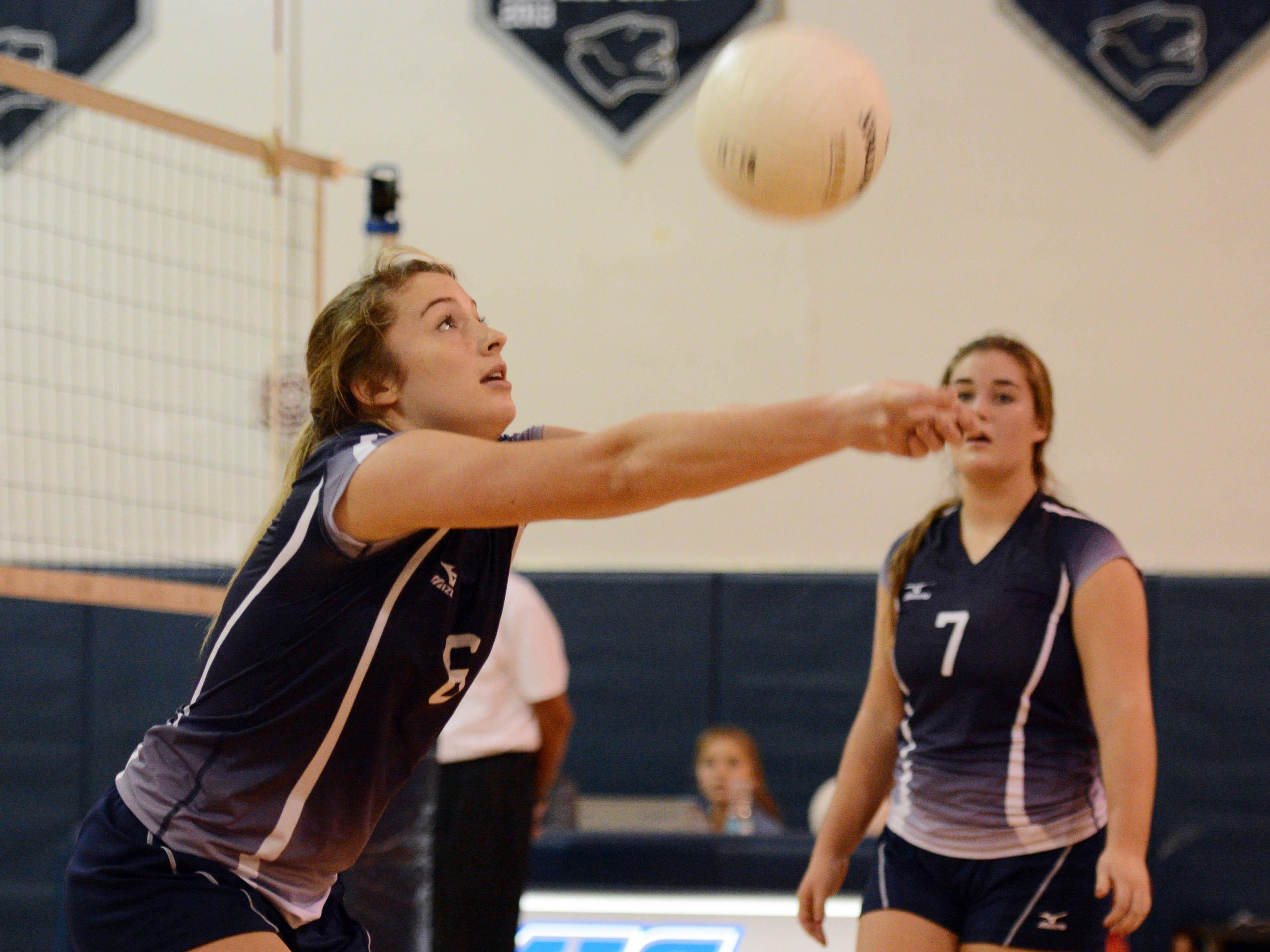 Merritt Island Christian's Macy Phillips passes to a teammate during Tuesday's regional quarterfinal volleyball match.
