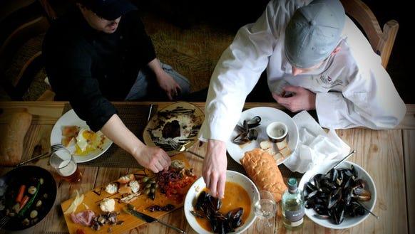 Liquid Assets chefs sample new menu items.