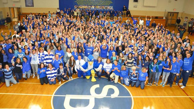 Facualty and staff from Stephen Decatur have a rally to show their pride after recent events at the school