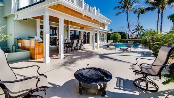 This three-bedroom, five-bath$1.4 million home in Vero Isles has an open patio with a pool and barbecue area.