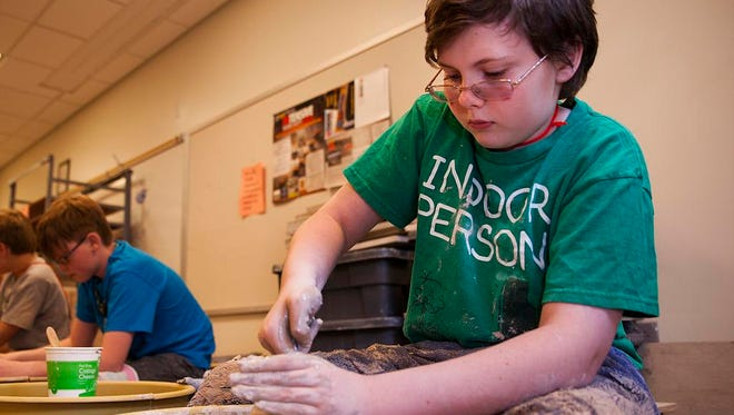 Thomas Vann, 14, works on a pottery wheel during a â??Learning Can Be Funâ? summer session at Blue Ridge Community College in Weyers Cave on Monday, July 7, 2014.