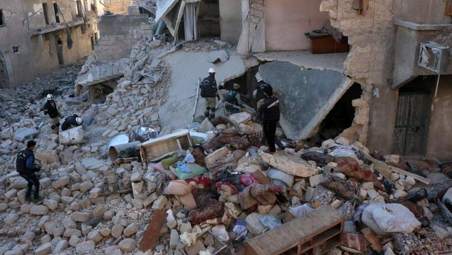 Rescue workers check through rubble in the northern Syrian city of Aleppo on Feb. 12.