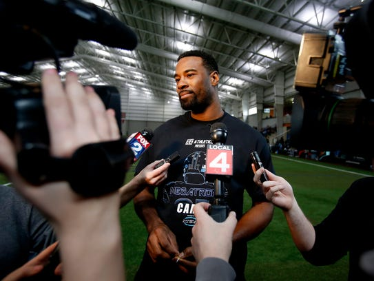 Calvin Johnson answers questions from the media on Saturday in Pontiac.
