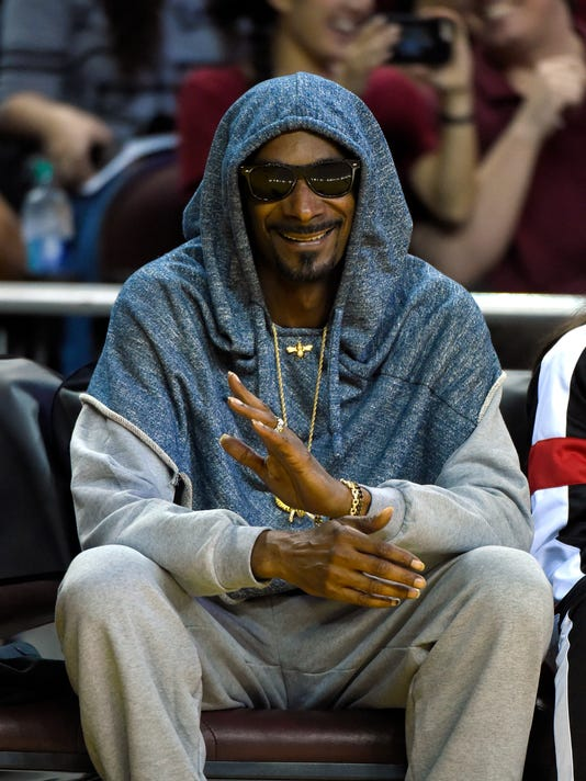 Rapper Snoop Dogg watches during the first half in Game 3 of the WNBA Finals between the Los Angeles Sparks and the Minnesota Lynx, Friday, Oct. 14, 2016, in Los Angeles. (AP Photo/Mark J. Terrill)