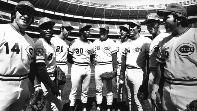 The Reds' Great Eight? won nearly 80 percent of their games over the 1975-76 seasons along the way to winning back-to-back World Series. APRIL 8, 1976: Little Chance Of Rain As Reds Take On Houston Astros In Season Opener: It will be clear and cool for the World Champion Cincinnati Reds opening game at 2:30 p.m. today at Riverfront Stadium. The starting line up includes four left handed and four right handed hitters and pitcher Gary Nolan. Flanking Nolan (38) from the left are left handed batters Pete Rose (a switch hitter), Joe Morgan, Cesar Geronimo and Ken Griffey, and right handers Dave Concepcion, Tony Perez, George Foster and Johnny Bench. They will face the Houston Astros. The National Weather Service predicts a high temperature in the mid 50s and little or no chance of rain for the opener. More on the machine, Opening Day fun, see special section and page C-3. The Enquirer/Fred Straub