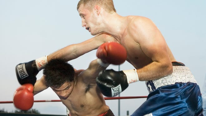 In this file photo, Stevie Weimer, right, throws a right hand at Melchor Guillen Jr. during Weimer's victory in 2009.