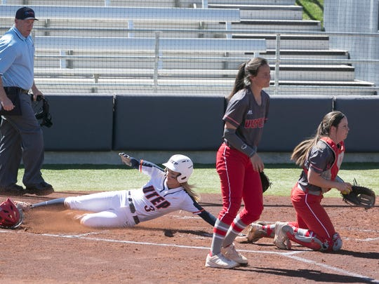 UTEP's Courtney Clayton, 3, slides in for a run against Western Kentucky Saturday at the Helen of Troy softball complex.