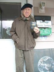 Garry Davis stands outside his South Burlington home